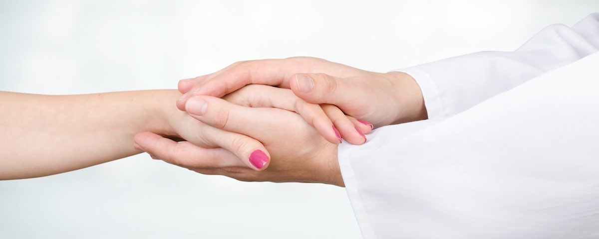 Doctor holding patient hand close up. doctor patient hand health care holding medical support concept
